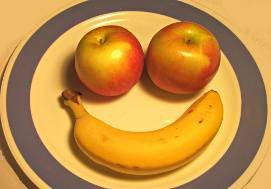 plate with apples and banana